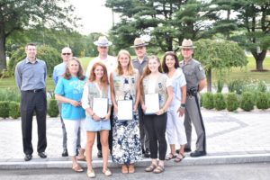 Major Robert C. Gregory presented three Red Hook teens with Certificates of Achievement