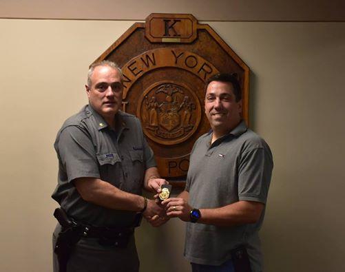 Major Robert C. Gregory the Troop K Commander congratulates Sergeant/Station Commander Craig A. Hernandez on his retirement