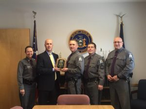 Captain Michael A. Jankowiak is presented with the Chairman's Award from SEFA