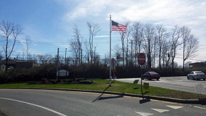 American Flag Waves Proudly  Over County's Veterans Memorial Highway