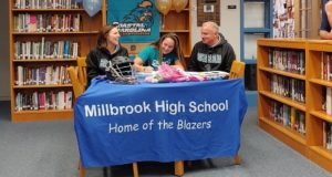 Claire Martell of Millbrook signs National Letter of Intent to play Division Lacrosse at Coastal Carolina University!