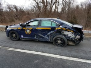 Driver ticketed for failing to move over after striking a State Police vehicle on the Thruway.