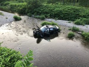DEPUTIES INVESTIGATING A SERIOUS ONE CAR ACCIDENT IN COPAKE